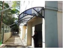 toldo de policarbonato para porta serviços no Sacomã